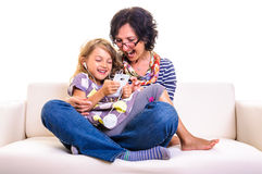 Family playing on cell phone Royalty Free Stock Photography