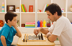 Family playing chess. Father and his son playing chess stock images