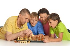 Family playing chess Stock Images
