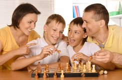 Family playing chess Royalty Free Stock Photography