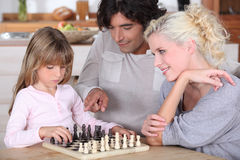 Family playing chess. At home Stock Photos
