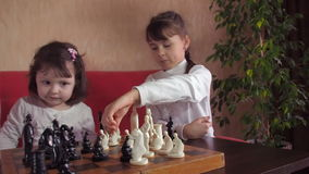 Family playing chess. Family playing chess at home on a red couch. Full hd stock video