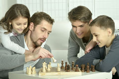 Family playing chess at home Stock Photos