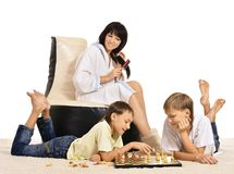 Family playing chess Stock Photos