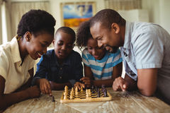Family playing chess together at home in the living room Royalty Free Stock Photos