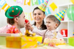 Family playing on child birthday Stock Photography