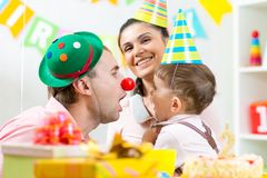Family playing on child birthday Royalty Free Stock Images