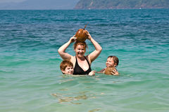 Family  is playing with a coconut Royalty Free Stock Image