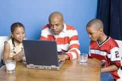 Family playing computer games royalty free stock photo