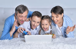 Family playing computer games Royalty Free Stock Images