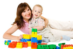 Family playing with constructor. Mother and little son playing with bright block. White isolated Stock Images