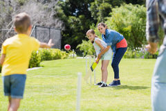 Family playing cricket in park Royalty Free Stock Photography