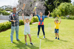 Family playing cricket in park. On a sunny day Stock Images