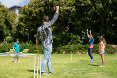 Family playing cricket in park. On a sunny day Royalty Free Stock Photo