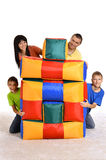 Family playing with cushions Royalty Free Stock Photo