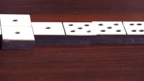 Family playing dominoes stock footage
