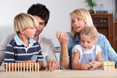 Family playing dominoes Stock Images