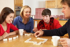 Family Playing Dominoes In Kitchen. Having Fun Stock Images