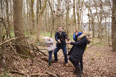 Family playing with fallen leaves in a wood, full length Stock Images