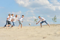Family playing footbal Royalty Free Stock Photo