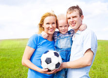 Family playing football Stock Photo