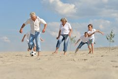 Family playing football Royalty Free Stock Image