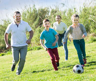Family  playing in football Royalty Free Stock Photo