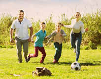 Family playing in football Stock Images