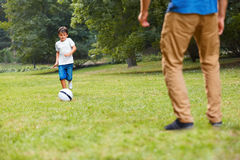 Family playing football. Father and son having fun. Stock Image