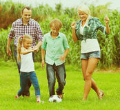 Family playing football on field Royalty Free Stock Photos