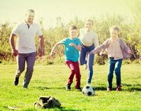 Family  playing in football Stock Photo