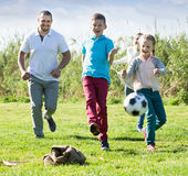 Family playing in football Stock Photos