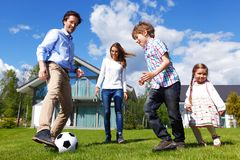 Family playing football Royalty Free Stock Photos