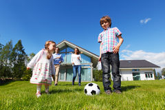 Family playing football Stock Photography