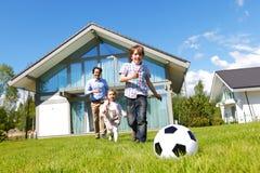 Family playing football Stock Image