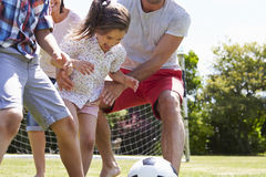 Family Playing Football In Garden Together Stock Images