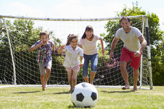 Family Playing Football In Garden Together Royalty Free Stock Image