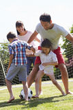 Family Playing Football In Garden Together Royalty Free Stock Images
