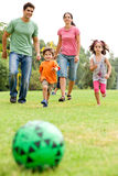 Family playing football in the park Royalty Free Stock Photos