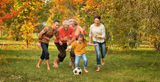 Family playing football Stock Image