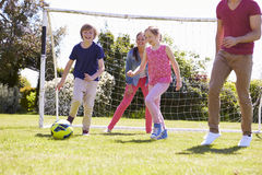 Family Playing Football Together Royalty Free Stock Photography