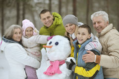 Family playing in fresh snow Royalty Free Stock Photos