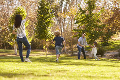 Family Playing With Frisbee In Park Together Royalty Free Stock Images