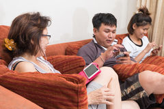 Family playing game on smart phone Stock Photos