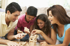 Free Family Playing Game Together At Home Royalty Free Stock Photos - 12405958