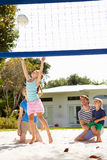 Family Playing Game Of Volleyball In Garden Stock Photography