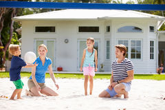 Family Playing Game Of Volleyball In Garden Stock Images