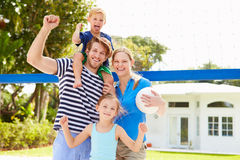 Family Playing Game Of Volleyball In Garden Royalty Free Stock Image