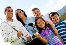 Family playing golf Stock Image