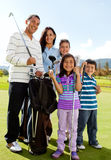 Family playing golf Stock Images